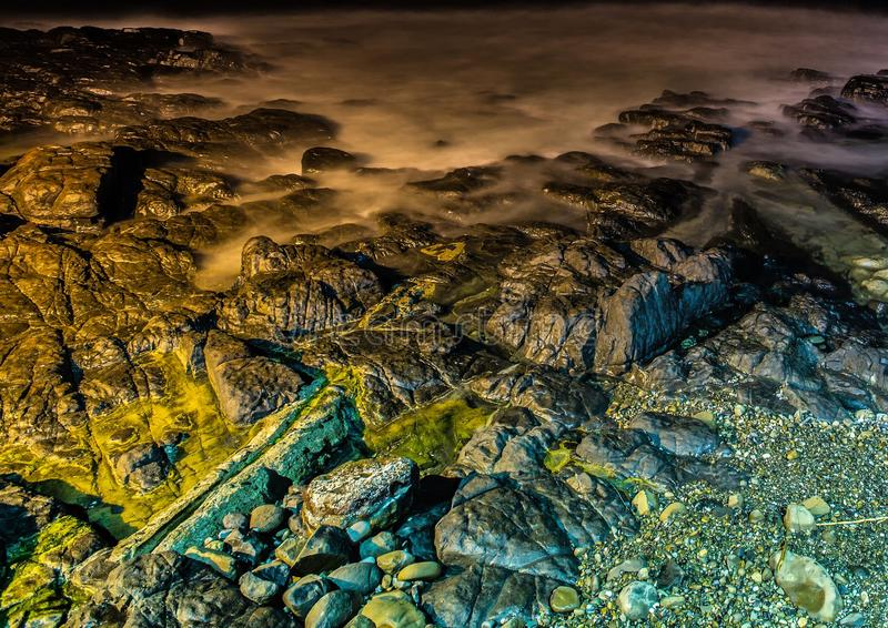 Nightshot of the waves and rocks at the indian ocean at the Wild Coast. In South Africa royalty free stock photos