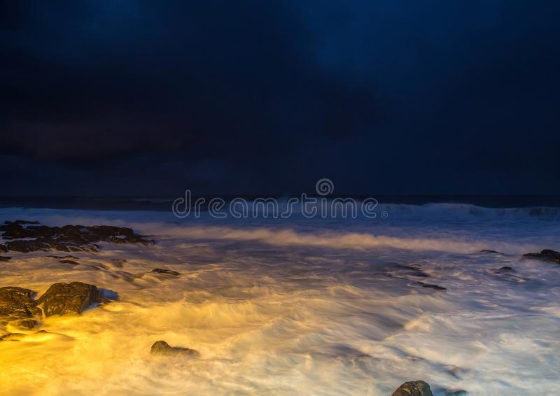 Nightshot of the waves and rocks at the indian ocean at the Wild Coast. In South Africa stock photo