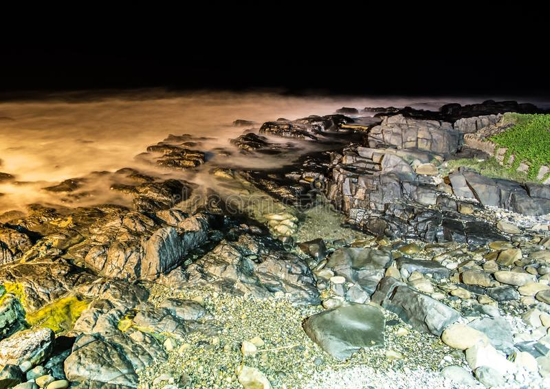 Nightshot of the waves and rocks at the indian ocean at the Wild Coast. In South Africa stock photography