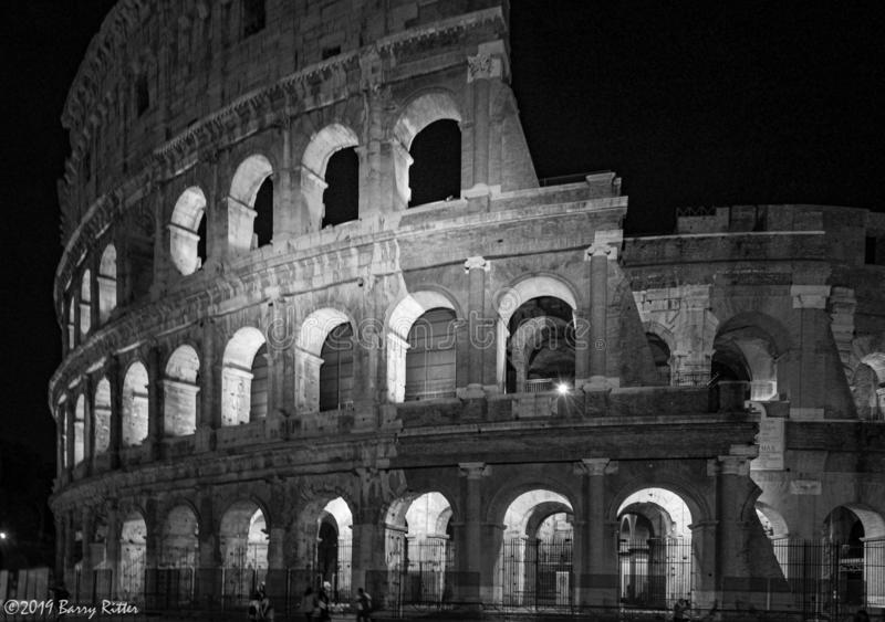 Nighttime at the Colosseum, Rome Italy. Black and white nighttime rendition of the Colosseum. Simple lighting of a classic building royalty free stock image