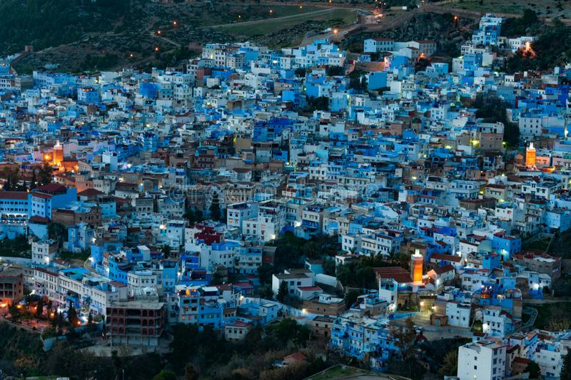 Blue and White Colored Homes and Buildings in Chefchaouen Morocco at Night. A nighttime long exposure image of blue and white colored buildings in the blue city stock image