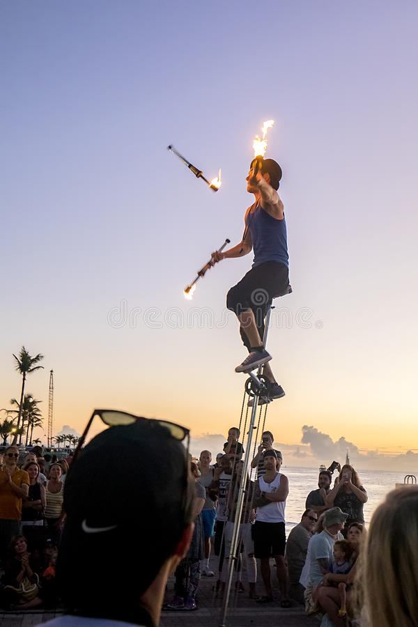 Street Juggler at Mallory Square, Key West. A nighttime street juggler is performing with fire at Mallory Square, Key West at sunset royalty free stock image
