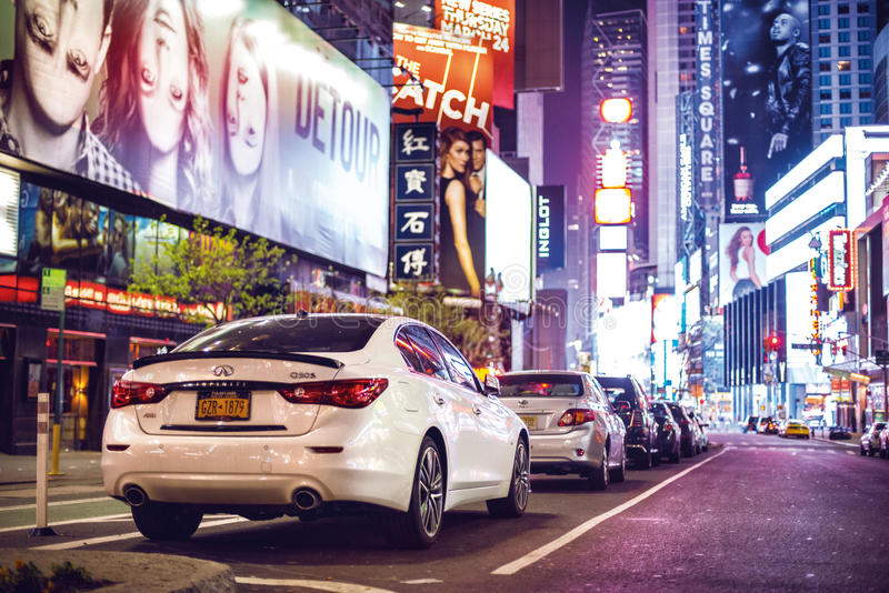 Nighttime in Times Square features with car parking city lights in New York City on April 18, 2016 royalty free stock photography
