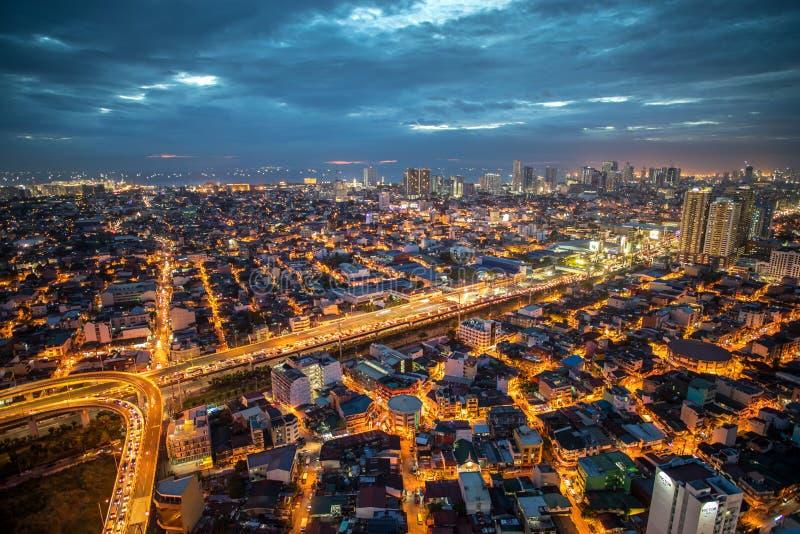Nightview för Manila stadshorisont, Manila, Filippinerna arkivfoto