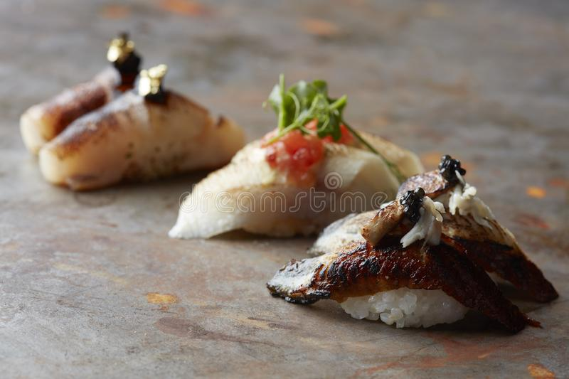 Nigiri sushi with caviar and gold royalty free stock photography