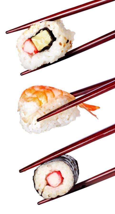 Sushi and chopsticks isolated on a white background stock photo
