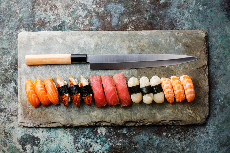 Nigiri Sushi and Japanese knife royalty free stock photo