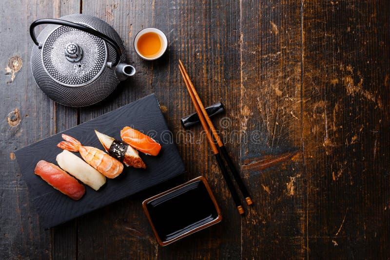 Nigiri sushi set and green tea stock photography