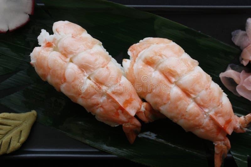 Nigiri sushi with shrimp and tuna fish on a gourmet platting on black background. royalty free stock photo