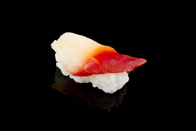 Nigiri Sushi or Surf Sushi. Hokkigai isolated on black background With the reflection of an object stock photos