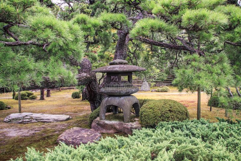 Beautiful stoned lanterns in nijo castle grounds , kyoto, kansai, Japan stock photo