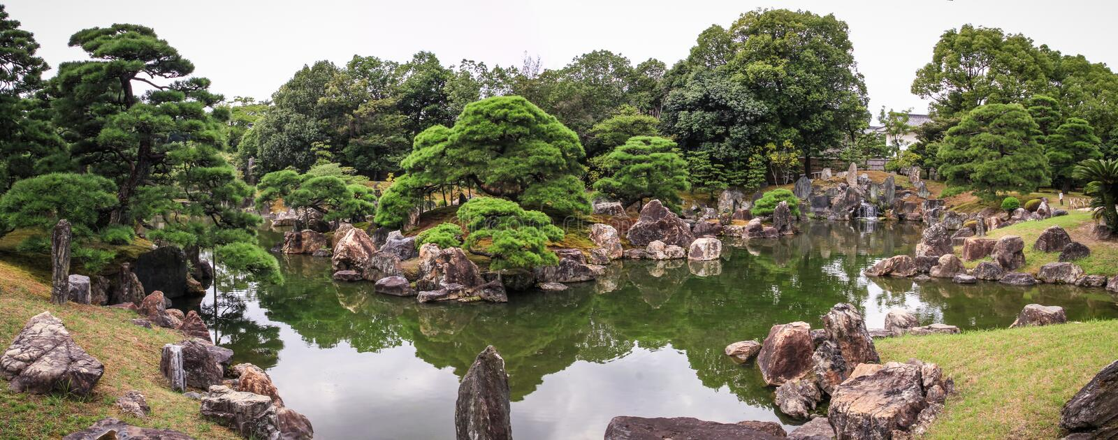 Nijo castle gardens panoramic view, kyoto, kansai, Japan. Nijō Castle is a flatland castle in Kyoto, Japan. The castle consists of two concentric rings Kuruwa royalty free stock photo