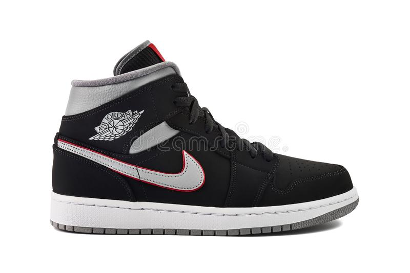Nike Air Jordan 1 Mid Black, Grey, Red and White Sneaker Editorial ...