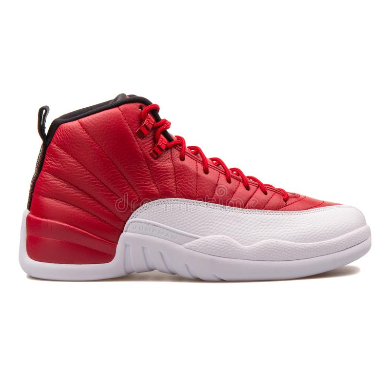 Nike Air Jordan 12 Retro gym red-black and white sneaker isolated on white background royalty free stock photography