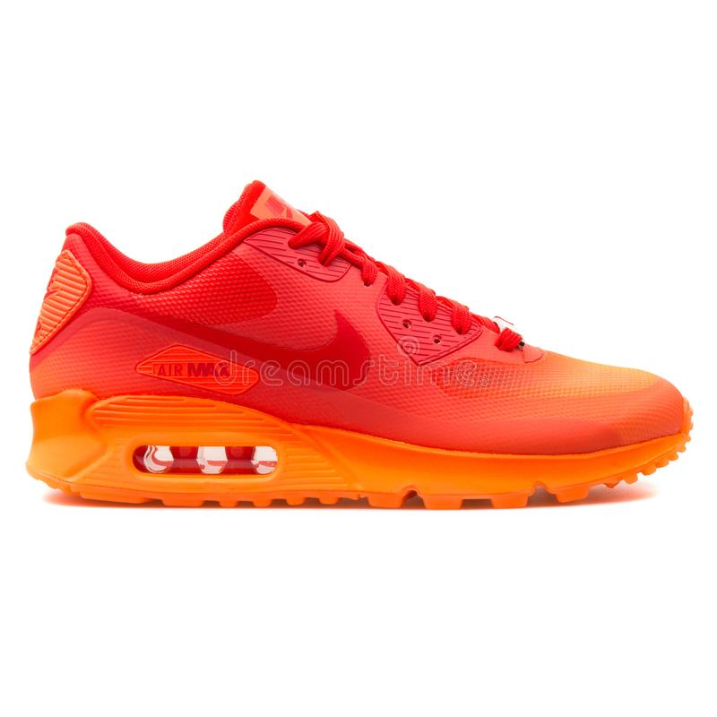Nike Air Max 90 Hyp QS orange and red sneaker. VIENNA, AUSTRIA - AUGUST 25, 2017: Nike Air Max 90 Hyp QS orange and red sneaker on white background royalty free stock photography