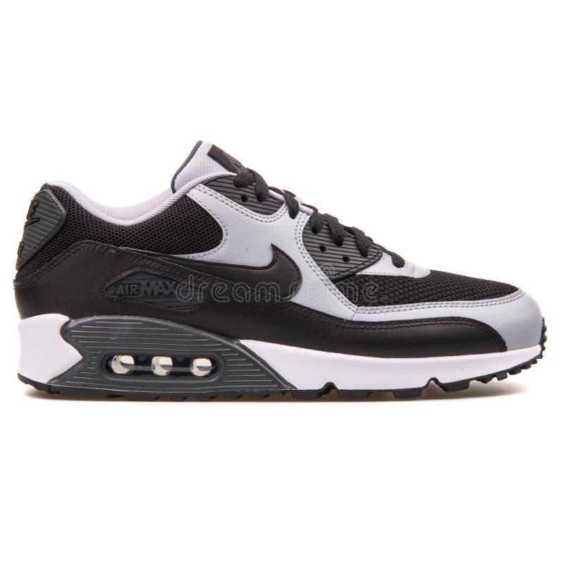 Nike Air Max 90 sapatilhas pretas e cinzentas essenciais fotografia de stock royalty free