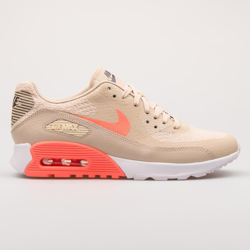 Nike Air Max 90 Ultra 2.0 beige and orange sneaker. VIENNA, AUSTRIA - AUGUST 23, 2017: Nike Air Max 90 Ultra 2.0 beige and orange sneaker on white background royalty free stock images