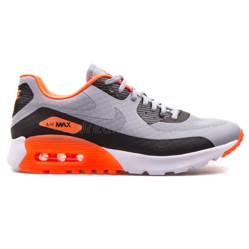 Nike Air Max 90 Ultra BR grey, black and orange sneaker. VIENNA, AUSTRIA - AUGUST 25, 2017: Nike Air Max 90 Ultra BR grey, black and orange sneaker on white stock image