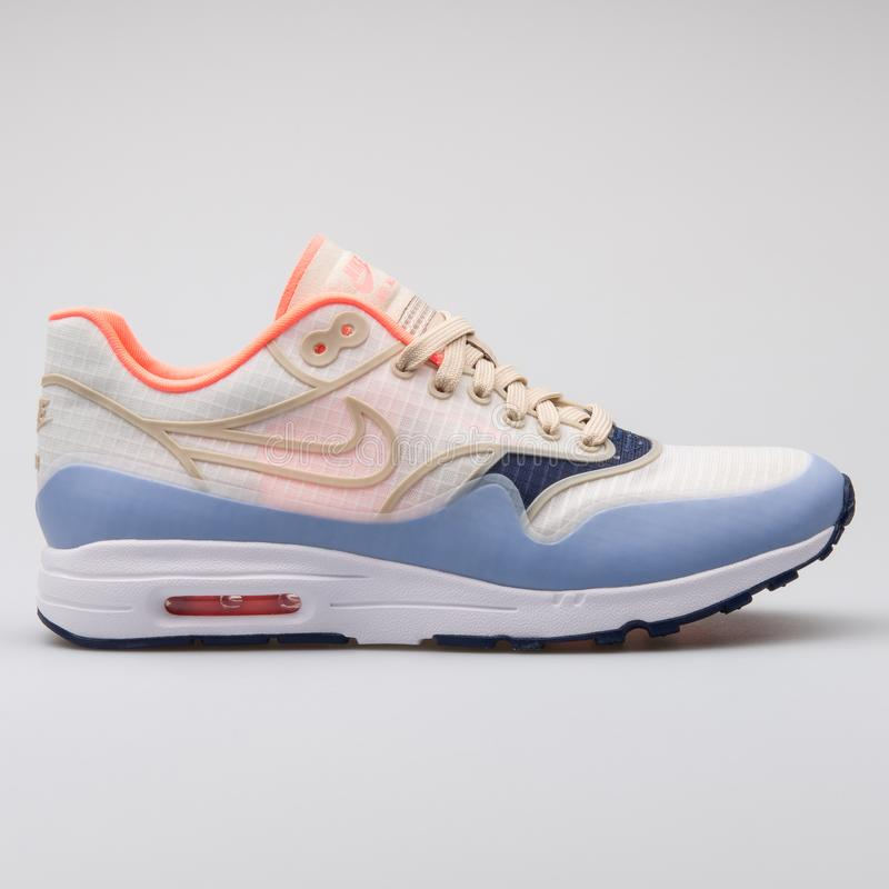 Nike Air Max 1 Ultra 2.0 SI beige, blue and orange sneaker. VIENNA, AUSTRIA - AUGUST 7, 2017: Nike Air Max 1 Ultra 2.0 SI beige, blue and orange sneaker on white royalty free stock photography