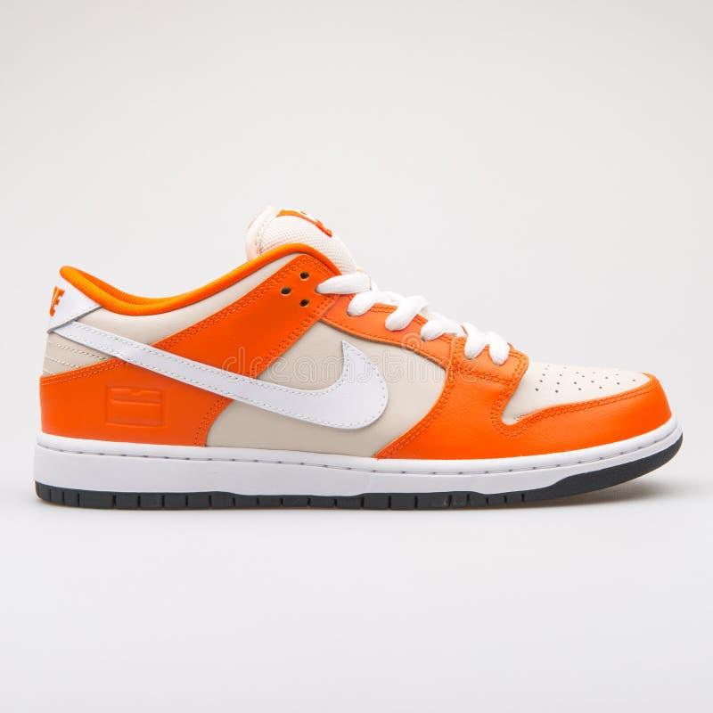 Nike Dunk Low Premium SB orange sneaker. VIENNA, AUSTRIA - AUGUST 23, 2017: Nike Dunk Low Premium SB orange sneaker on white background stock photos
