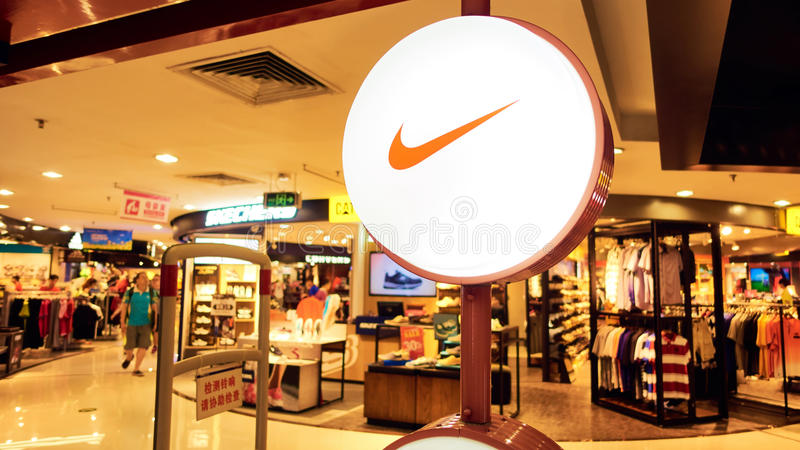 Nike. Fashion shop with logo and sign. Front of  sports retail store stock photo