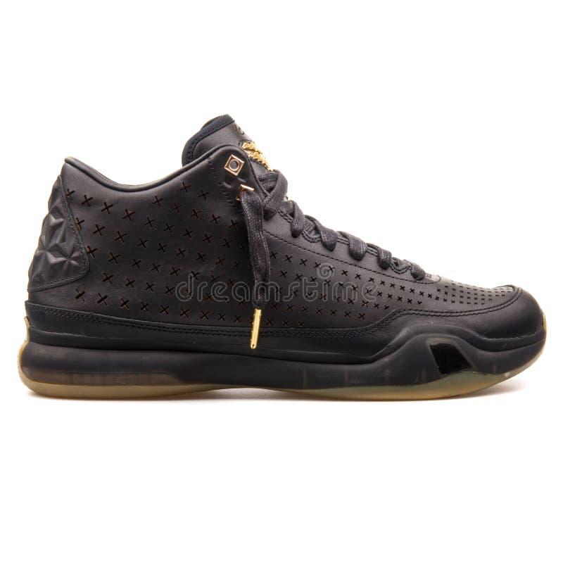 Nike Kobe X de Medio zwarte tennisschoen van Ext. royalty-vrije stock afbeeldingen