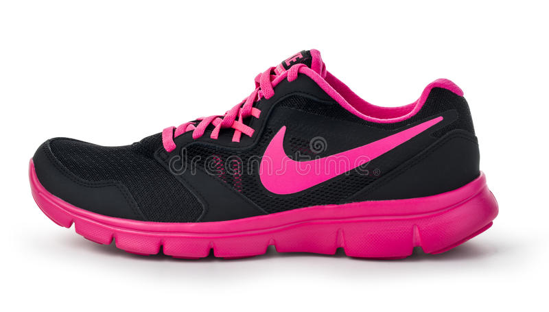 Nike lady`s - women`s running shoes. Chisinau, Moldova- May 27, 2015: Nike lady`s - women`s running shoes - sneakers - trainers, in gray and pink, showing the royalty free stock photo