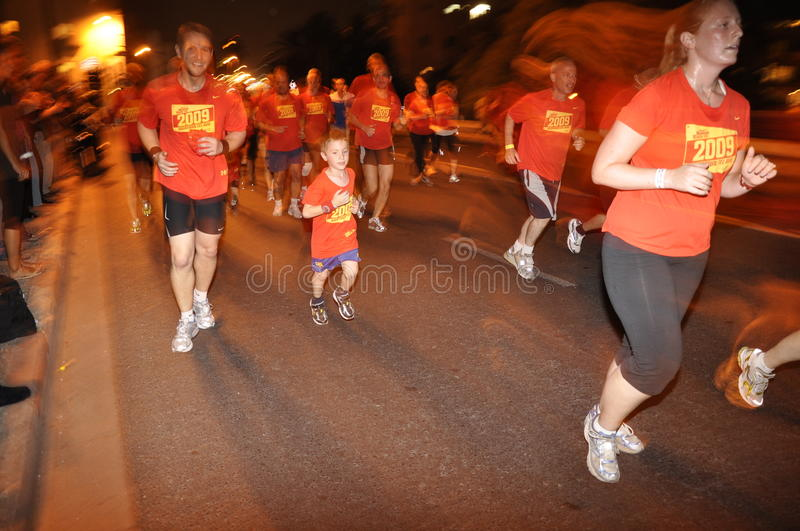 Nike NightRun Tel-Aviv - the youngest participant stock images