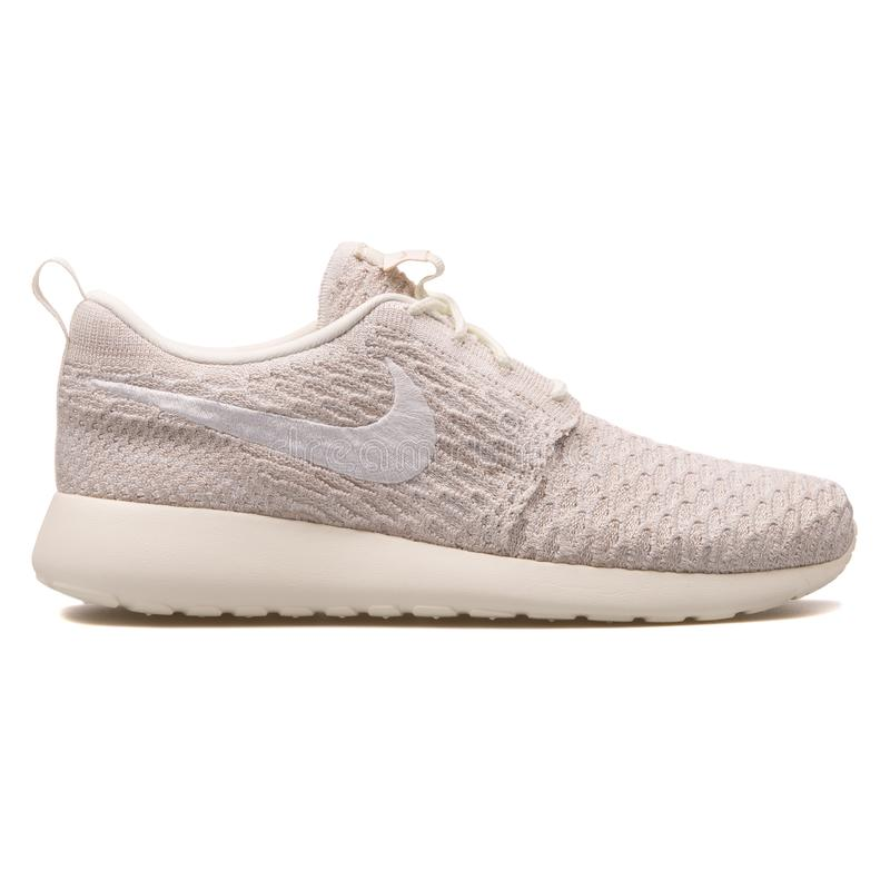 Nike Roshe One Flyknit sail white sneaker royalty free stock photos