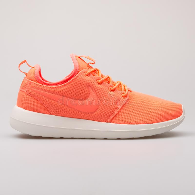 Nike Roshe Two orange sneaker. VIENNA, AUSTRIA - AUGUST 28, 2017: Nike Roshe Two orange sneaker on white background stock photos
