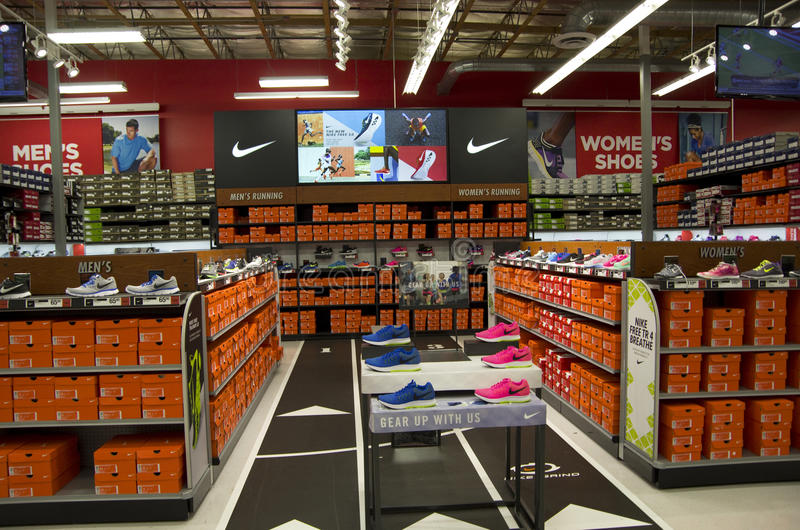 Nike shoes in Sports Authority. Big section of Nike shoes in a Sports Authority near Seattle royalty free stock photo