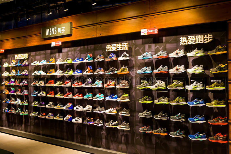 Nike specialty store. A Nile specialty store in China:Rows of sneakers on shelves royalty free stock photo