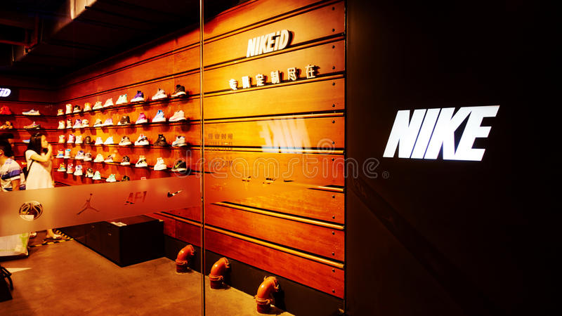 Nike. Sports shoes store with logo. Front of  retail shop window royalty free stock photography