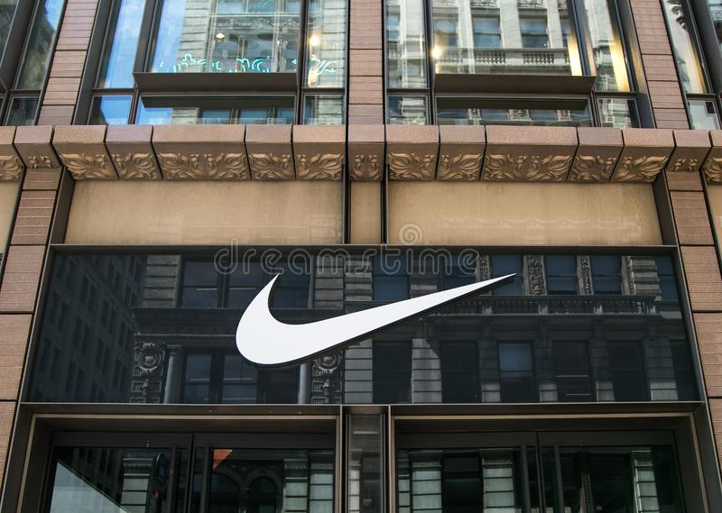 Nike swoosh above store entrance. New York, 6/15/2019: Nike`s logo is displayed above the entrance to their store in SoHo royalty free stock photos
