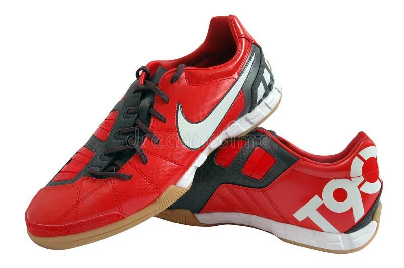 Nike vermelho ostenta sapatas fotografia de stock royalty free
