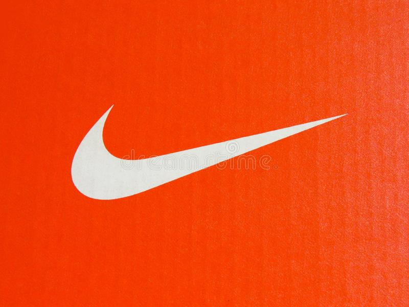 Nike white logo on cardboard orange sneakers box. Belgrade, Serbia -  July 11 2019. Nike swoosh. Nike white logo on cardboard orange sneakers box royalty free stock image