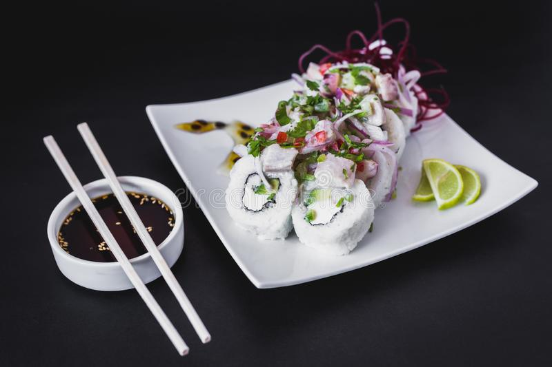 Nikkei Ceviche Roll on a dark table royalty free stock photos