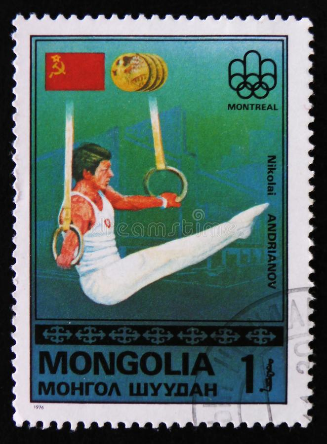 Nikolai Andrianov, Montreal Games Emblem, USSR Flag, Gold Medals, from the series `Gold medal winners`, circa 1976. MOSCOW, RUSSIA - APRIL 2, 2017: A post stamp stock photo