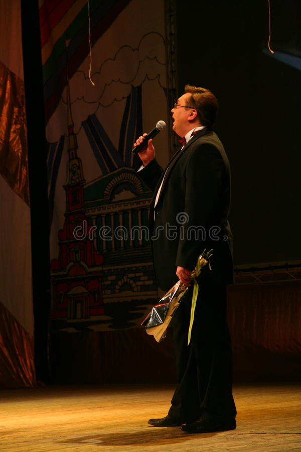 Nikolay Y. Pozdeev - Entertainer, ready for anything. Master of ceremonies, entertainer at a charity concert for the world war II veterans and residents of royalty free stock images