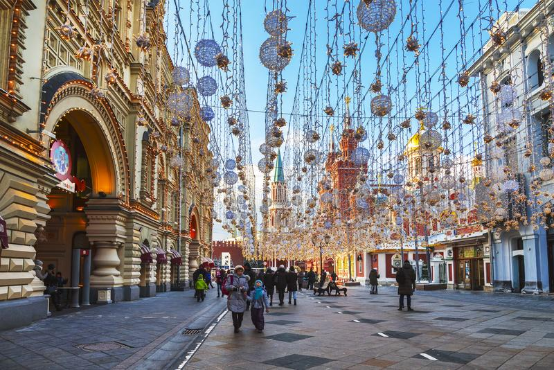 Nikolskaya street decorated in New year and Christmas holidays and tourists walking on it, Moscow. Russia stock photo