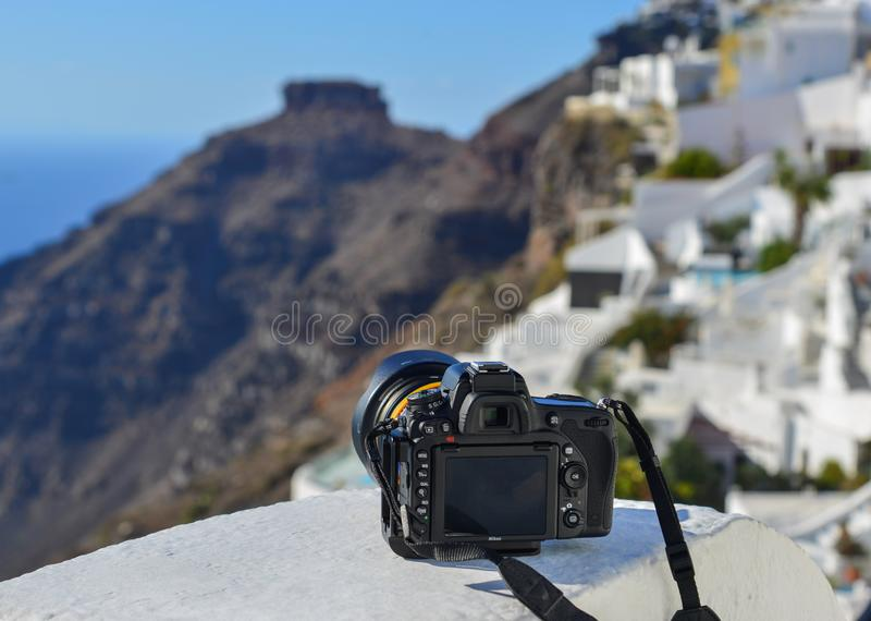 A Nikon D750 DSLR camera with lens. Santorini, Greece - Oct 4, 2018. A Nikon D750 DSLR camera with lens on the white balcony at Oia Village in Santorini Island royalty free stock photos