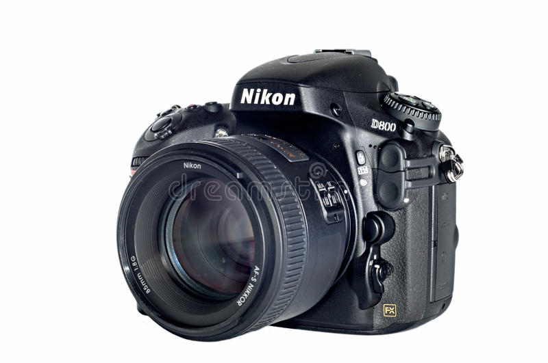 Nikon D800 isolated. Nikon D800 professional digital SLR camera with big lens stock photo
