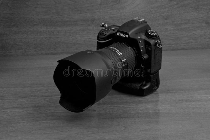 Nikon D750 with MB16. Picture of a Nikon D750 camera with a MB16 battery grip. Shown with a 24-70 mm lens stock image