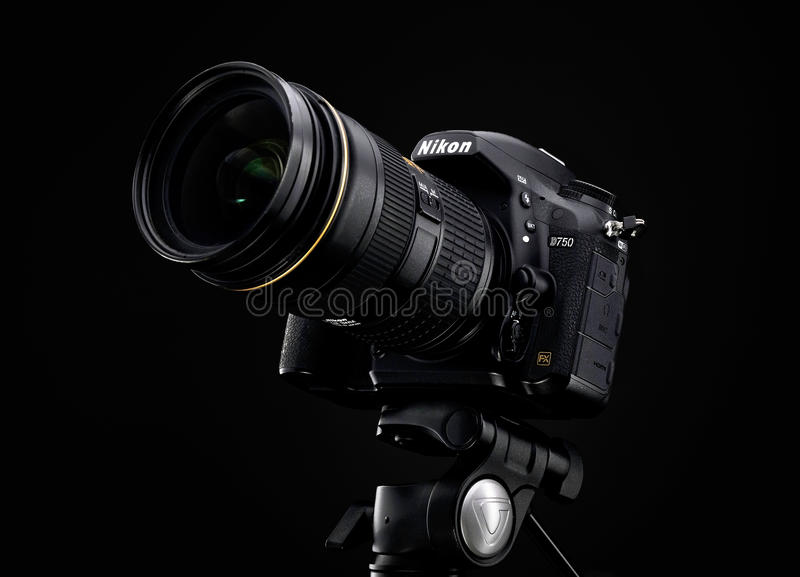 Nikon D750 and Zoom lens over black background. MINSK, BELARUS, JANUARY 04, 2017: Nikon D750 and Zoom lens over black background royalty free stock images