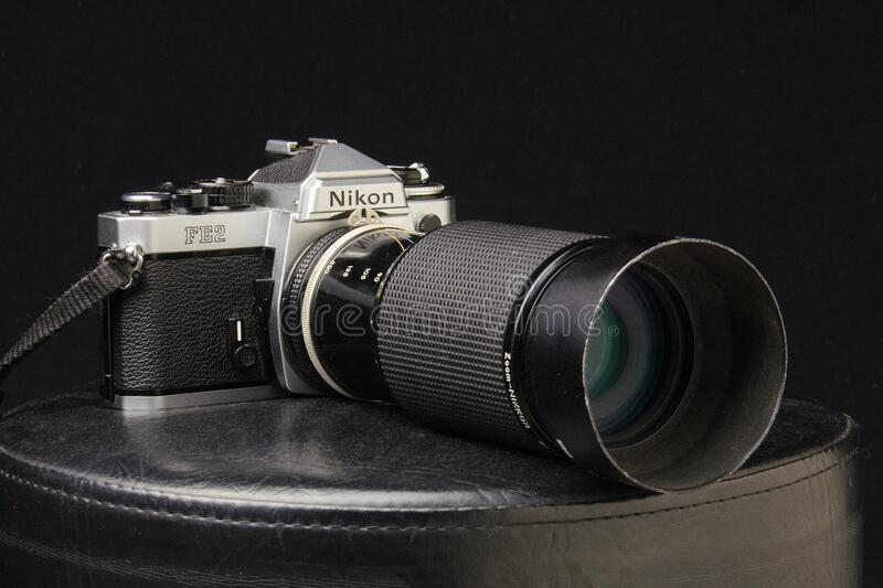Nikon FE2 and telephoto lens stock images