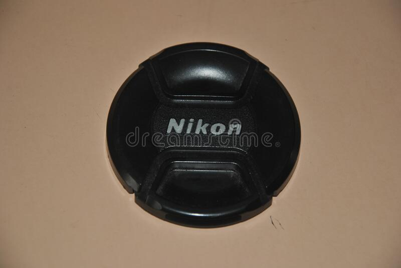 Nikon lens cap big size. Nikon 18-200 lens cap big size absolutely new jet black in color royalty free stock images