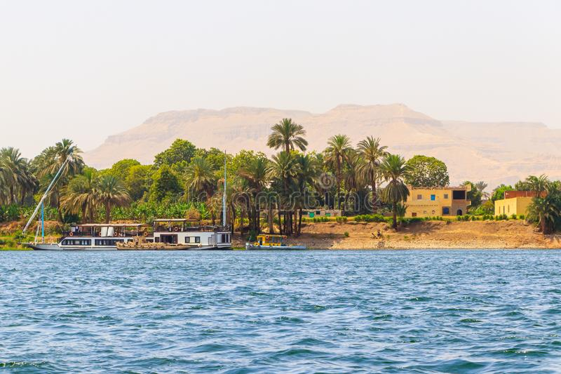 Nile river in the heart of Luxor city, Egypt. Nile River is the longest river in the world. Its basin includes parts of Tanzania, Burundi, Rwanda, the Democratic stock photography