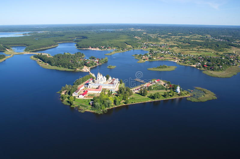 The Nilo-stolobenskaya (Nil) deserts and lake Seliger. View Nilo-Stolobensky (Nil) deserts - Orthodox monastery and the lake Seliger from a height royalty free stock photo