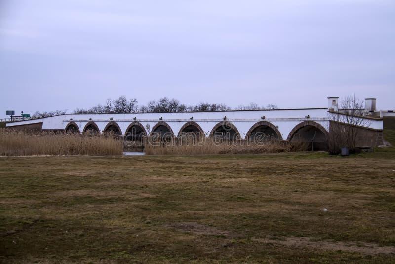 Nine-arched Bridge. The Nine-arched Bridge is the most identifiable symbol of the Hortobagy National Park, Hungary's great plain. The 167 m long bridge spanning stock image