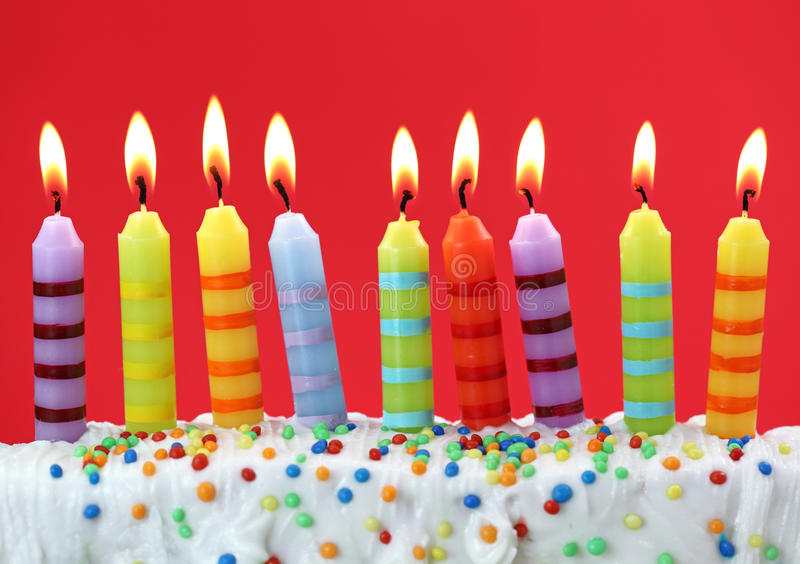 Nine birthday candles. On red background royalty free stock images